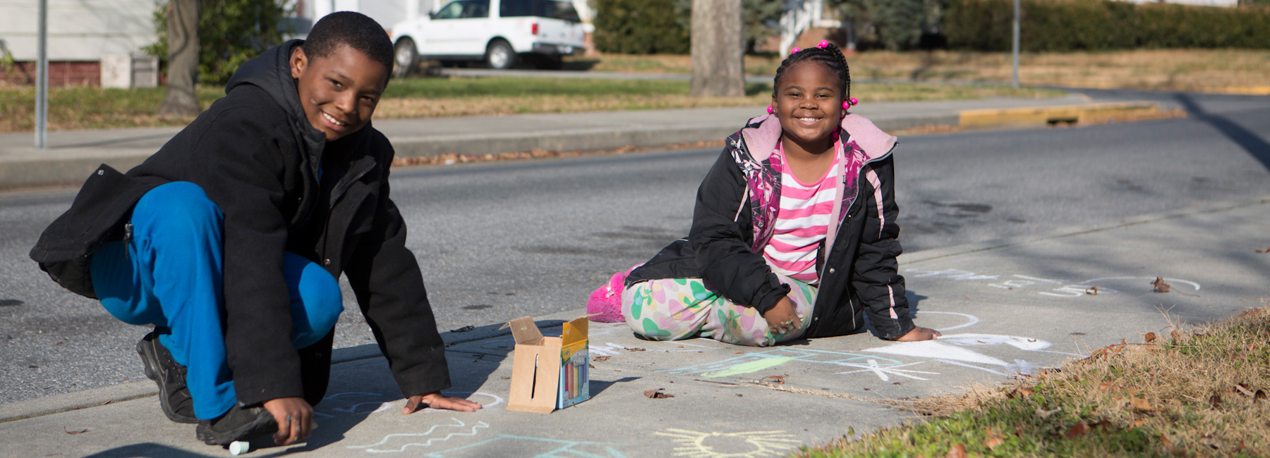 Children on the sidewalk - Salisbury Neighborhood Housing Services, Inc.